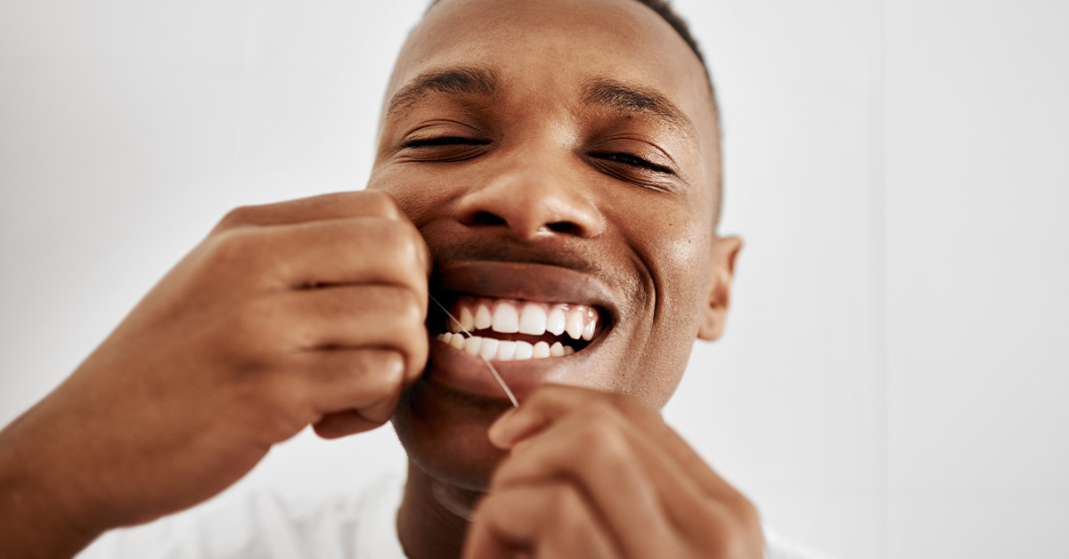 Should You Floss Before or After Brushing? Research and More