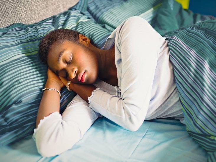 woman tired sleeping sleep bed 732x549 thumbnail 1.