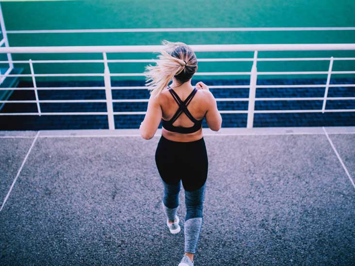 https://post.healthline.com/wp-content/uploads/2020/09/woman-exercising-at-stadium-thumb.jpg