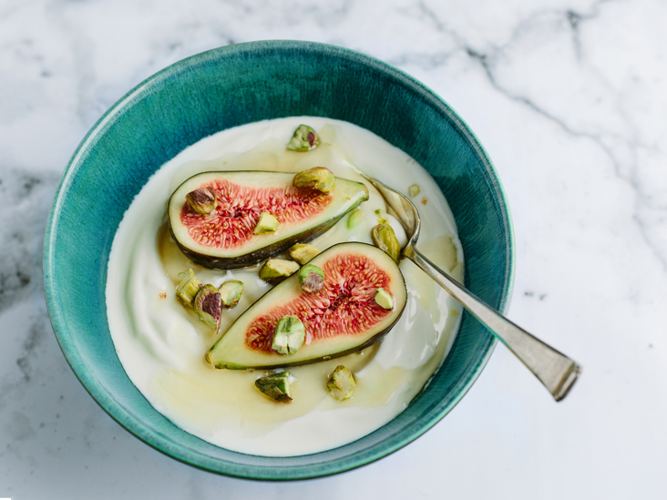 yogurt figs spoon in bowl 732x549 thumbnail.